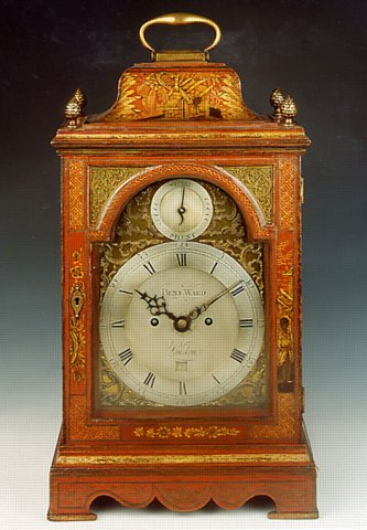 A George Iii Bracket Clock In An Inverted Bell Top Case Decorated With Well Patinated Red Lacquer